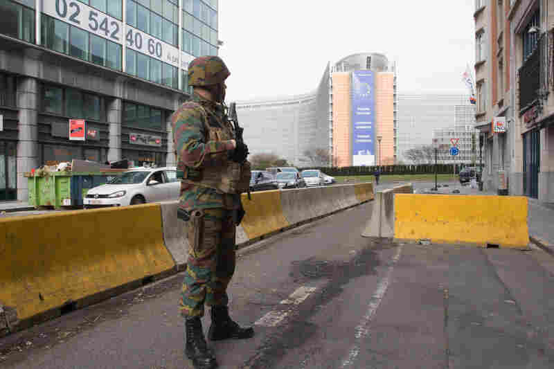 A Belgian soldier stands guard near the headquarters of the European Commission. There was an explosion at the nearby Maelbeek subway station during the morning rush hour on Tuesday.