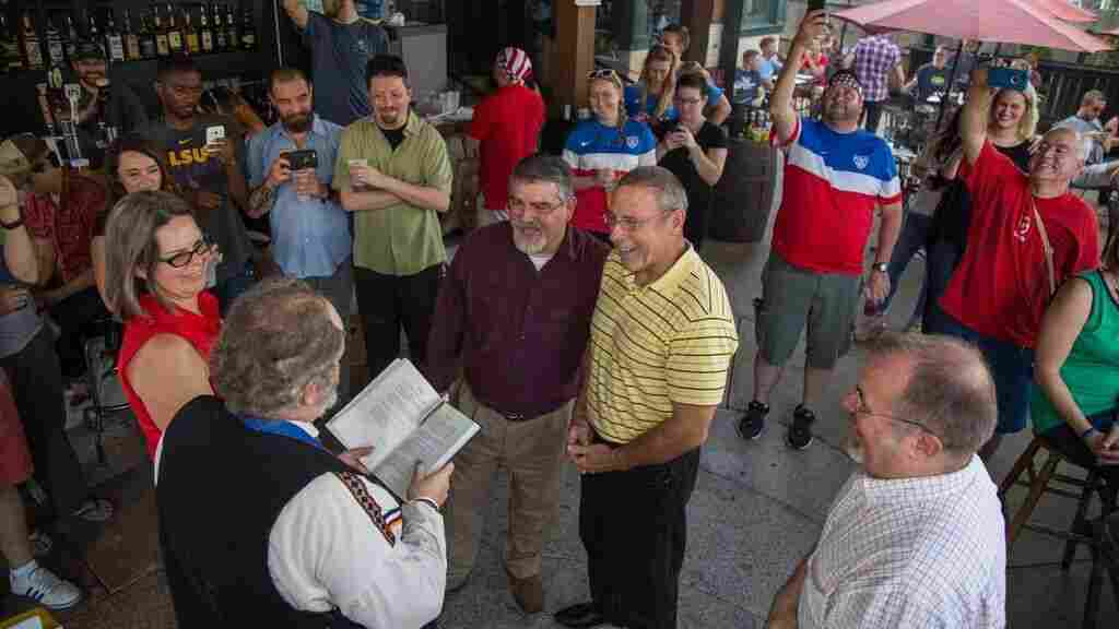 On June 26, 2015, just hours after the U.S. Supreme Court validated same-sex marriages, Dennis Clark (center left) and Mark Henderson exchanged vows in Midtown Memphis. This photo, later posted on Facebook, led to their suspension from Freemasons by the Grand Lodge of Tennessee.