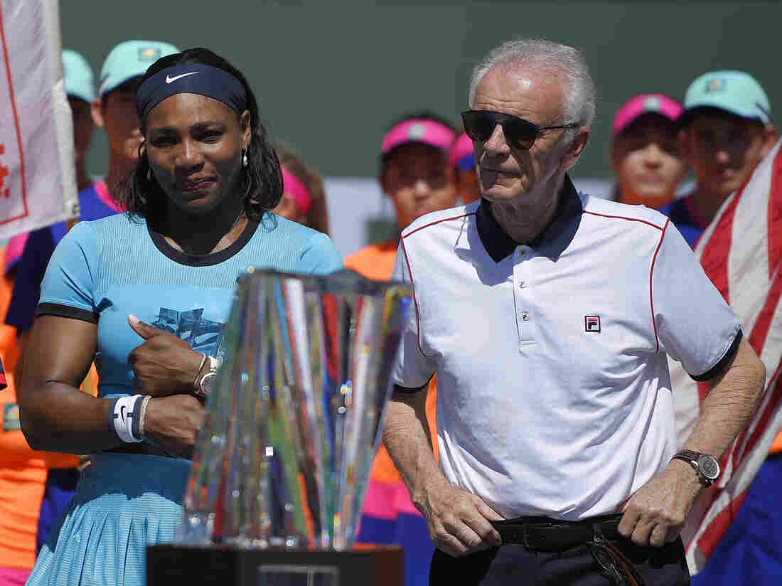Serena Williams stands with then-tournament director Raymond Moore on Sunday after Victoria Azarenka defeated Williams in a final at the BNP Paribas Open tennis tournament.