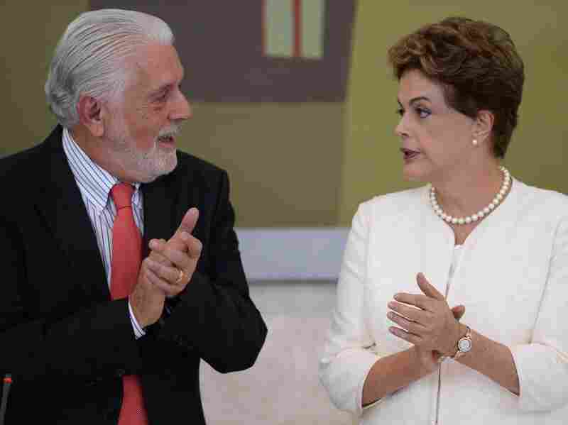 """Brazil's President Dilma Rousseff speaks with her chief of staff, Jaques Wagner, in January. Wagner was recorded telling Silva, the former president, it was """"good"""" that a female opposition politician was called a """"whore."""""""