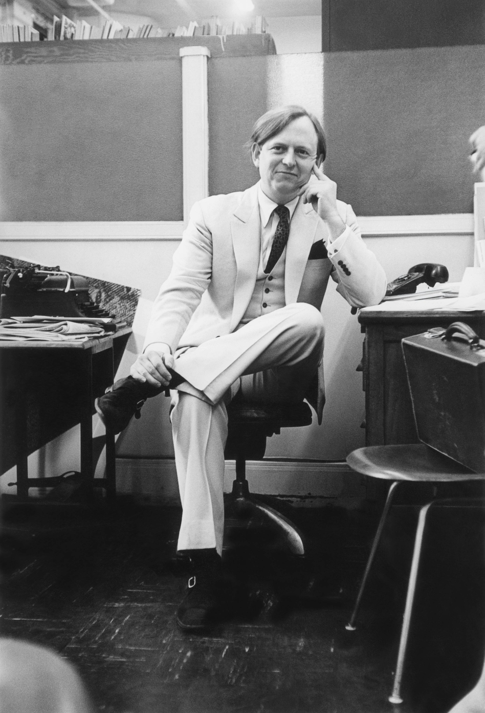 "Wolfe — in his signature white suit in 1966 — coined or popularized phrases that became part of the American lexicon, such as ""radical chic"" and ""The 'Me' Decade."""