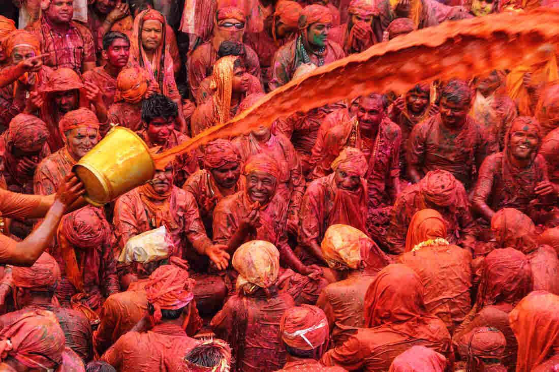 Paint, dye and colored water turn Holi celebrants into neon rainbows.
