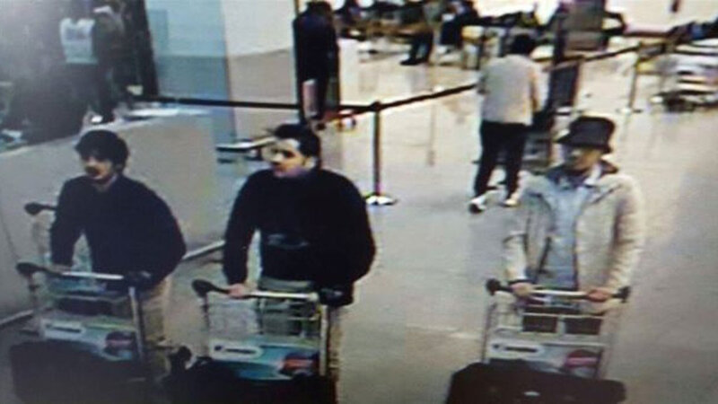 This image, provided by the Belgian Federal Police in Brussels, shows Ibrahim el Bakraoui (center), an unidentified attacker (left) and a wanted suspect (right) who is currently on the run.