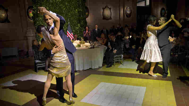 President Obama and first lady Michelle Obama (right) tango with dancers during the state dinner in Argentina on Wednesday.