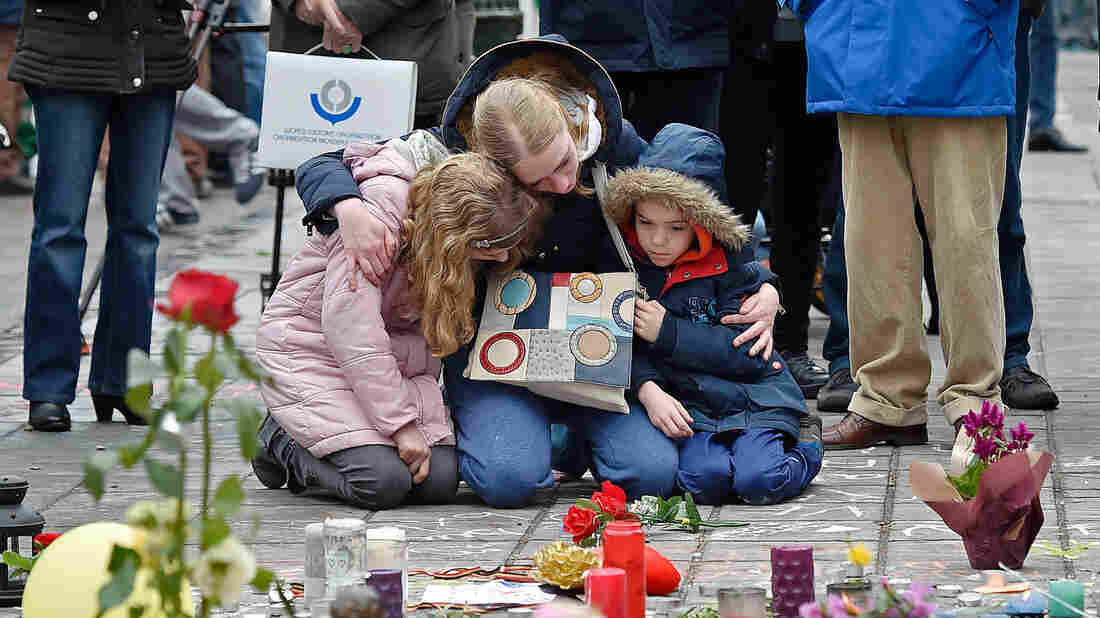 People mourn for the victims of the bombings at the Place de la Bourse, in the center of Brussels, on Wednesday.