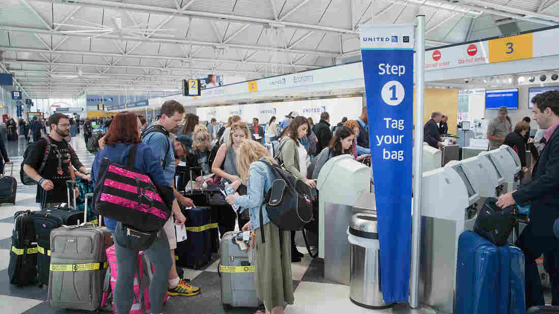 Passengers wait to check in at Chicago's O'Hare International Airport in June 2015. TSA screenings at U.S. airports are beyond ticket counters, baggage claim and other heavily trafficked areas. After terrorist bombings at the Brussels airport targeted those areas, U.S. officials are reconsidering how to keep them safe.