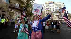 An evangelical Christian pilgrim from the U.S. waves during a parade in Jerusalem last October in an annual show of support for Israel.