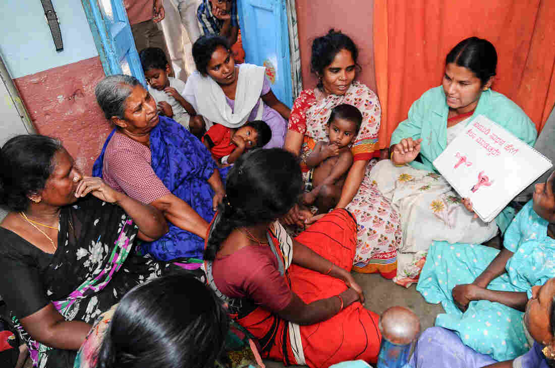 Women in Lucknow, India, learn how an IUD is inserted. A new device, allowing for easy and safe insertion after childbirth, is being tested.