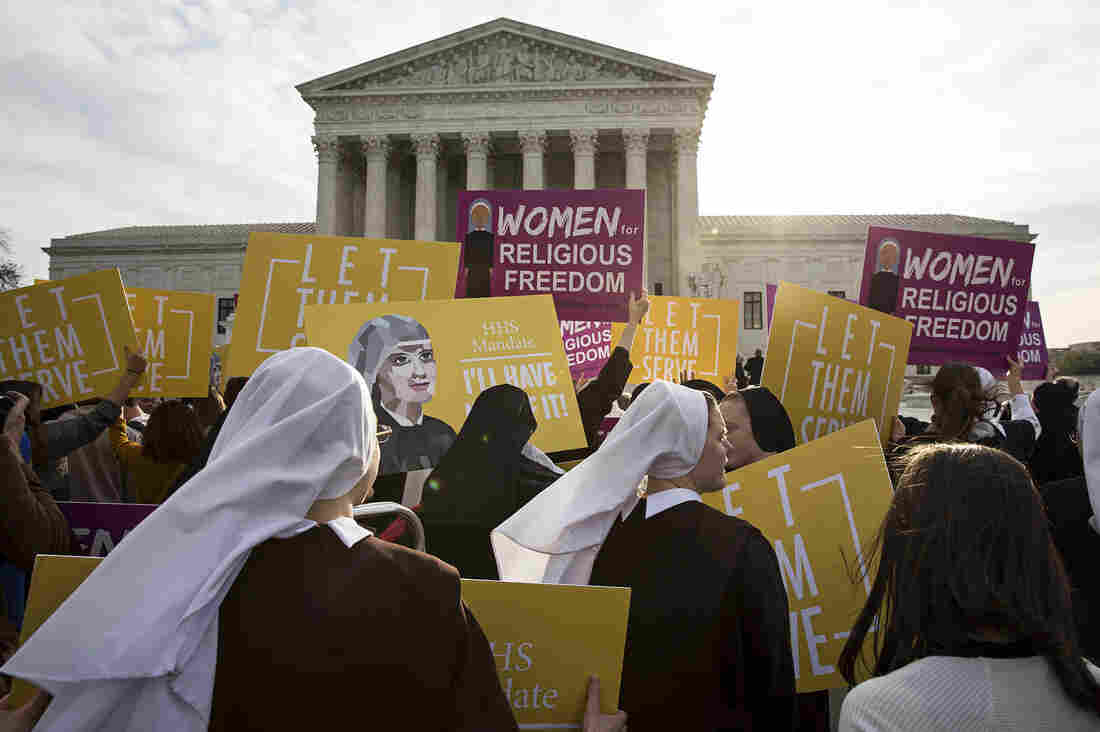 Nuns and others opposed to the Affordable Care Act's contraception mandate rally outside the U.S. Supreme Court Wednesday.