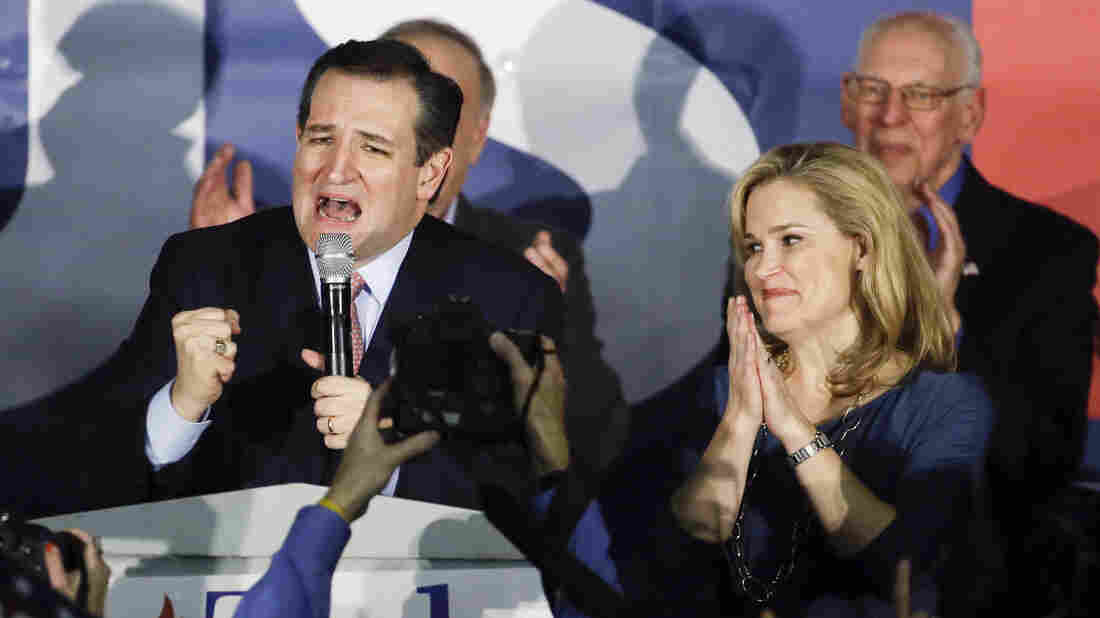 Republican presidential candidate Ted Cruz speaks during a caucus night rally as his wife, Heidi, listens, in February in Des Moines, Iowa.