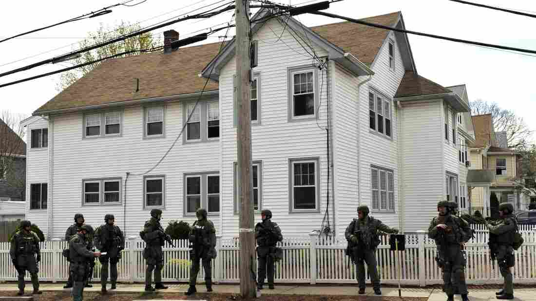 Law enforcement searches houses in Watertown days after the Boston Marathon bombing. Watertown resident Maria Van Ryn balked at the idea of Patriots Day re-creating the 2013 shootout in her neighborhood.