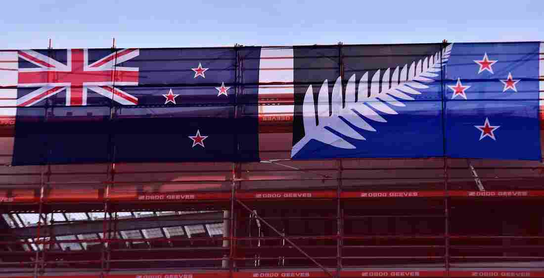 The current New Zealand flag (left) hangs next to the alternative flag on a building site in Wellington on March 4. New Zealanders began voting March 3 on whether to adopt a new flag.
