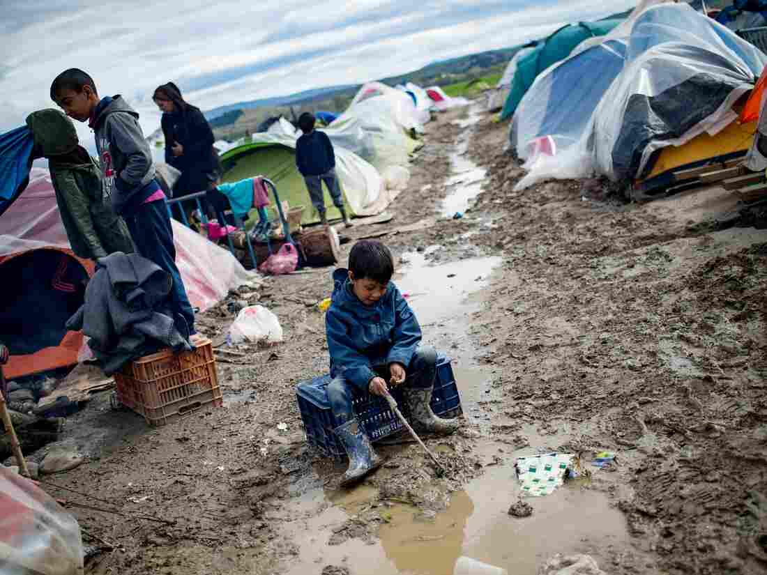 A boy plays in a puddle at a makeshift camp occupied by migrants and refugees at the Greek-Macedonian border near the village of Idomeni on Thursday.