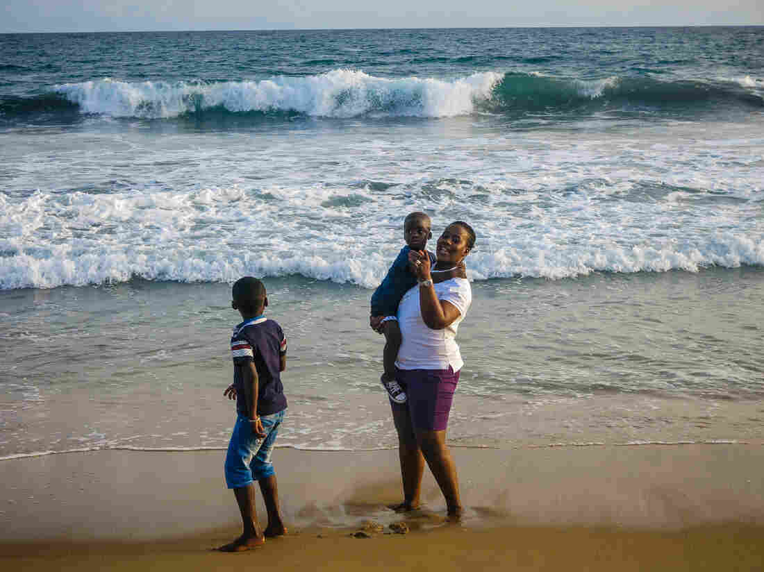 Salimata Sylla, a mother of three, visits Grand Bassam with her family to show she's not afraid of terrorists. On March 13, al-Qaida gunmen killed some 19 people at the beachfront town.