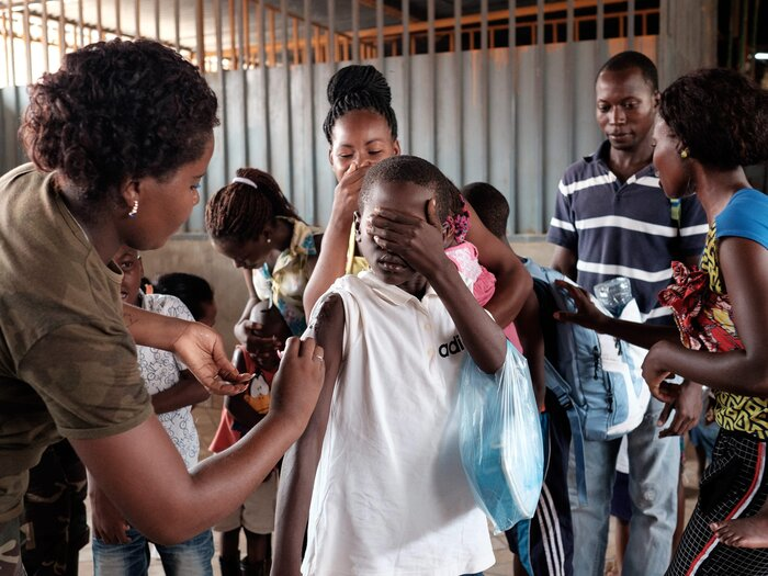 The Angolan military administers yellow fever vaccines at a market in Luanda, the capital city.