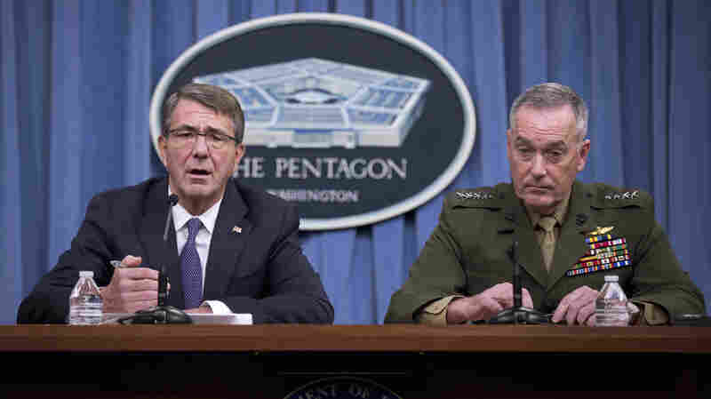Defense Secretary Ash Carter, accompanied by Joint Chiefs Chairman Gen. Joseph Dunford, speaks during a news conference at the Pentagon on Friday.