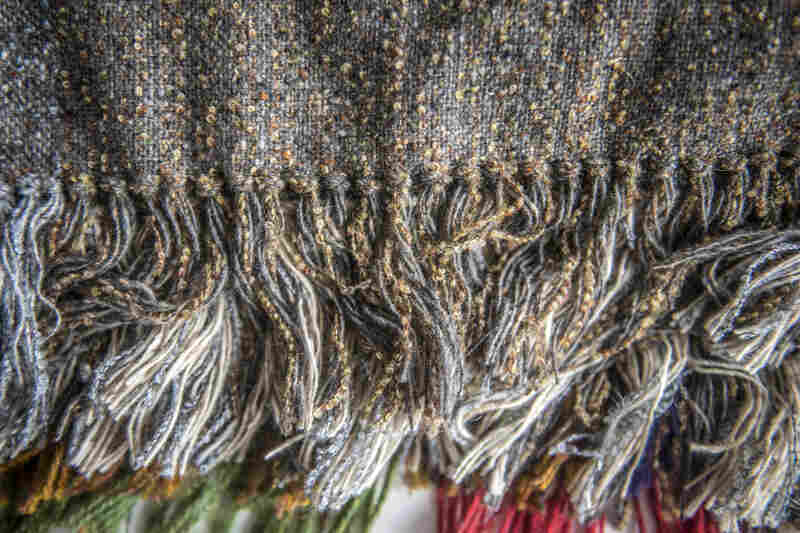 These modern tweed scarves made from soft Merino sheep's wool are woven at Studio Donegal in Ireland.