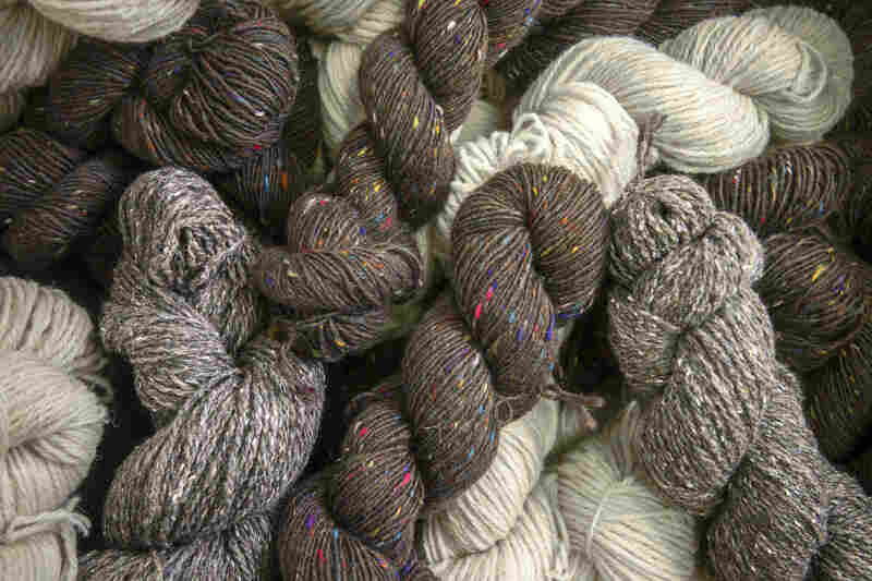 Skeins of hand-spun tweed yarns are obtained locally and used at Studio Donegal in Ireland.