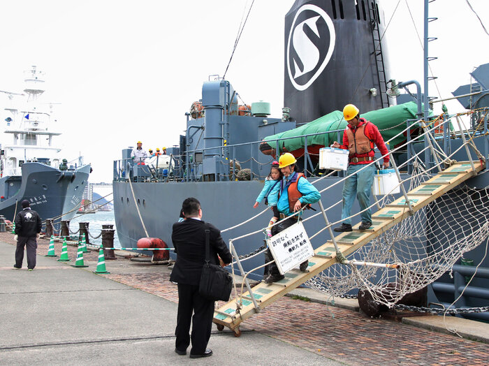 Workers disembark from a whaling ship at the port of Shimonoseki in western Japan on Thursday.