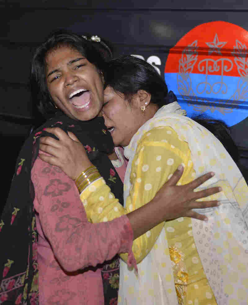 Women mourn the death of relatives after a bomb blast in Lahore, Pakistan, on Sunday.