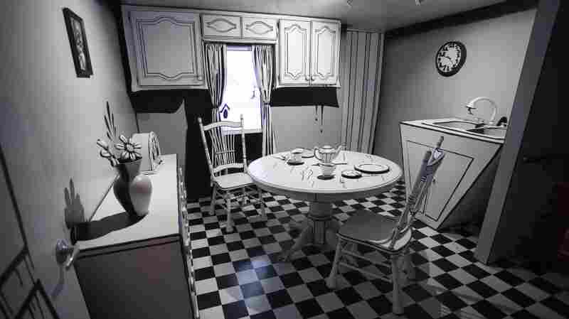 An interior view of the fictional Selig family's house. Here, in the kitchen, a portal — one of many — leads out of the house into the otherworldly beyond.