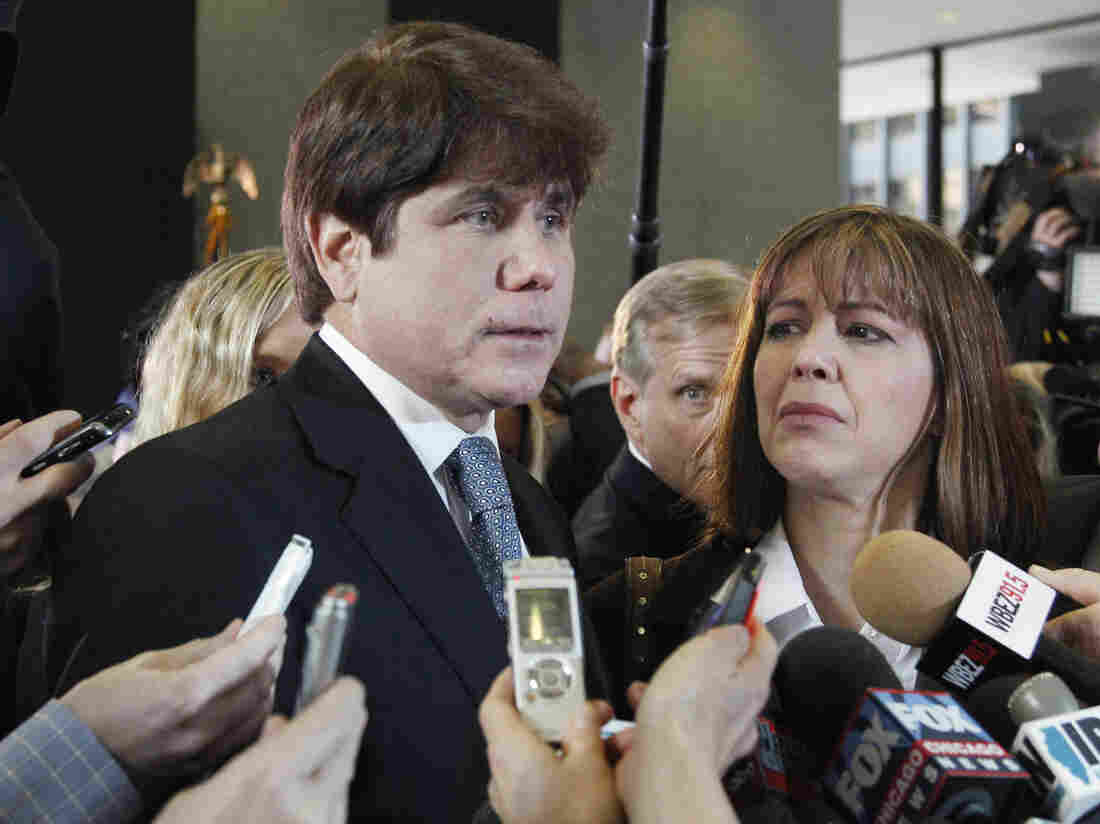 Former Illinois Gov. Rod Blagojevich, with his wife, speaks to reporters in 2011. On Monday, the U.S. Supreme Court rejected Blagojevich's appeal of his corruption convictions.