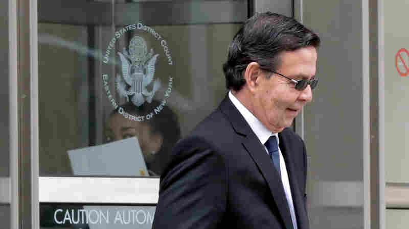 Former Honduran President Rafael Callejas leaves federal court in New York City on Monday after pleading guilty to conspiracy charges in a wide-ranging FIFA soccer scandal.
