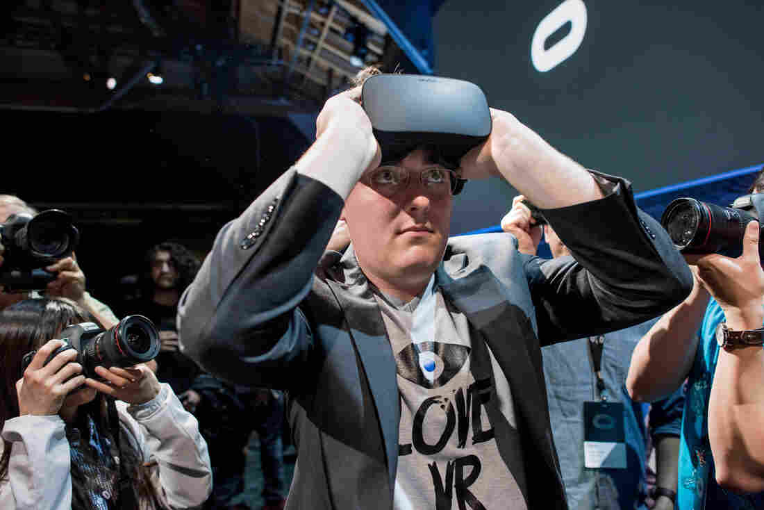 """Palmer Luckey, founder of Oculus VR, demonstrates the new Oculus Rift headset during the """"Step Into The Rift"""" event in San Francisco in June 2015."""