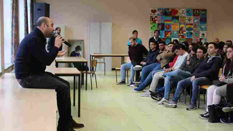 Playwright Ismaël Saïdi speaks to a mostly-Muslim students at a school in the Brussels district of Laeken, where two suicide-bombers grew up.