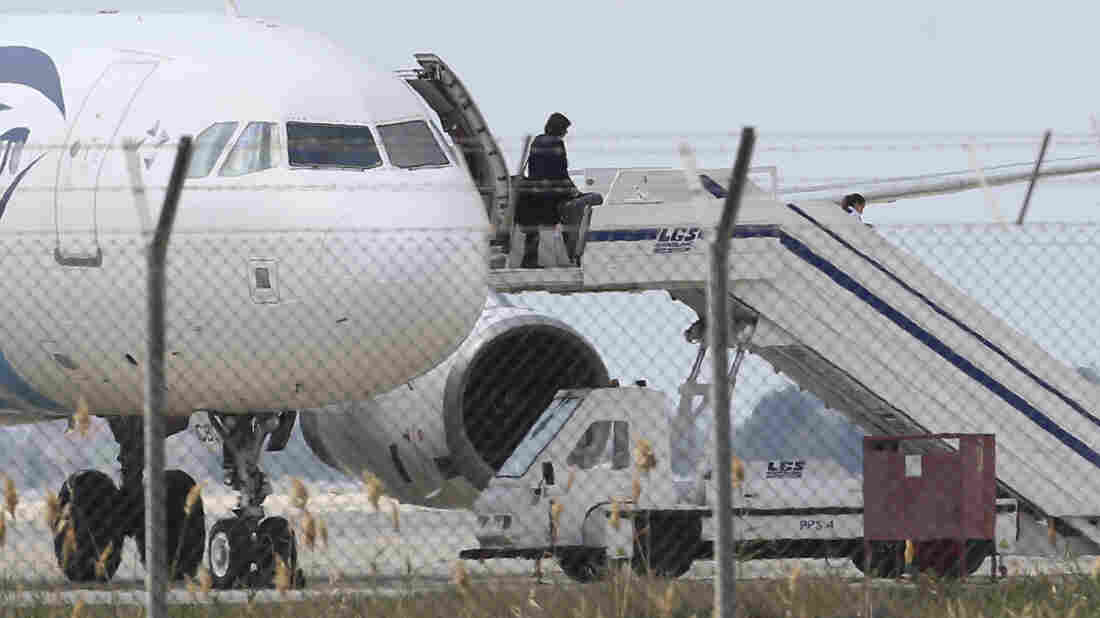 A passenger leaves a hijacked EgyptAir plane after it landed at Larnaca Airport in Cyprus.