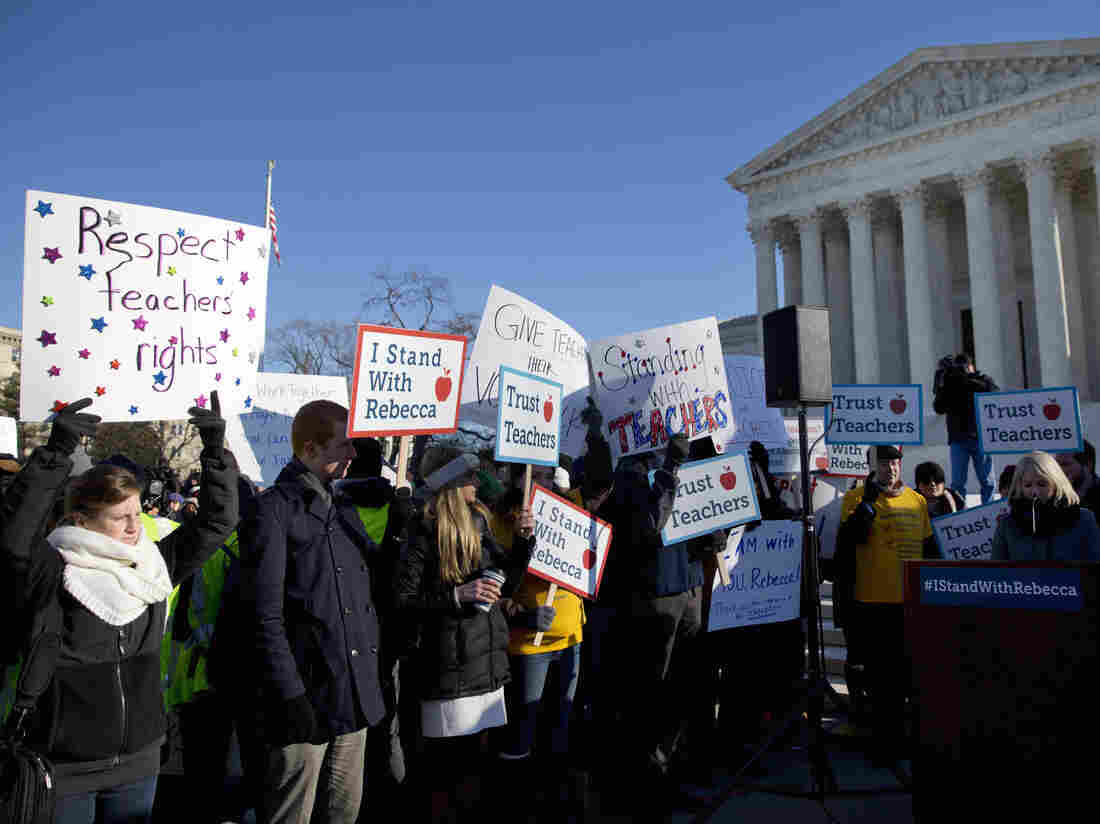People rally at the Supreme Court in Washington in January, as the court heard arguments in Friedrichs v. California Teachers Association.