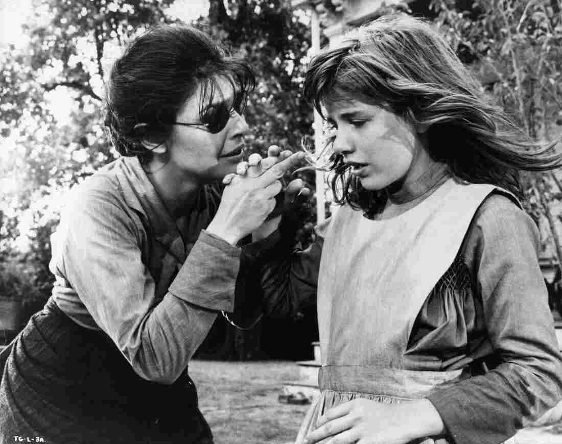 Anne Bancroft holds Patty Duke's hand to teach her a new word in a scene from the 1962 film The Miracle Worker.