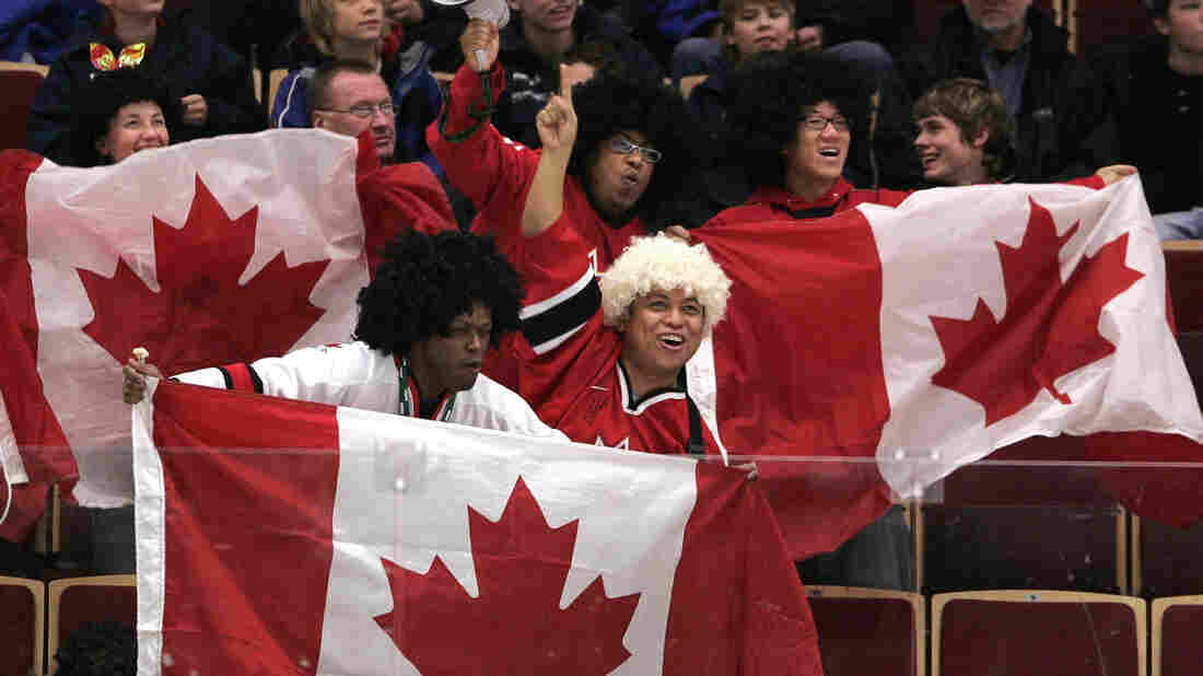 These hockey fans sure make being Canadian look like fun.
