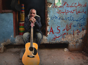 Guitarist Asad Ali from the Sachal Ensemble of Lahore, Pakistan.