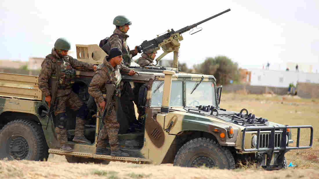Tunisian soldiers patrol the outskirts of Ben Guerdane, in southern Tunisia, on March 8. Islamic State extremists crossed over from nearby Libya on March 7. They were beaten back, but the episode raised concerns that Libya's chaos could spread to Tunisia.