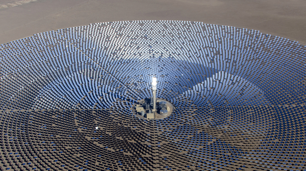 SolarReserve's Crescent Dunes Solar Energy Plant, located near Tonopah, Nev., features an array of 10,347 mirrors arranged in a circle 1.75 miles across. A 640-foot-tall tower glows when the sun's energy is concentrated and directed to the top. (SolarReserve)