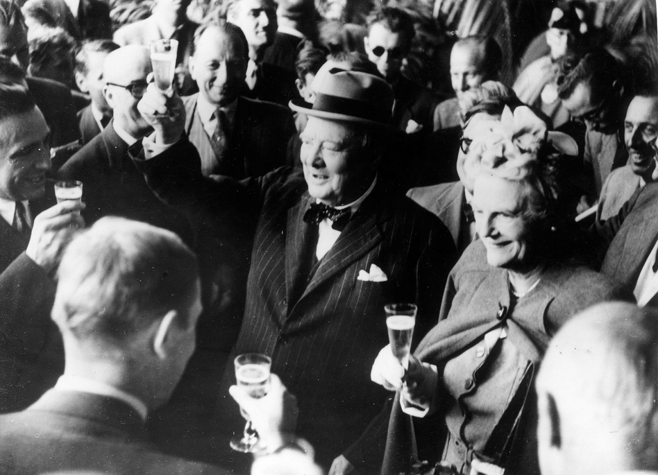British politician Winston Churchill and his wife, Clementine, make a toast upon their arrival in Switzerland in August 1946. Stories of Churchill's special relationship with alcohol are legendary — and champagne was his truest passion. A new book reveals the extent to which that passion imperiled his already threadbare bank balance. (Keystone/Getty Images)