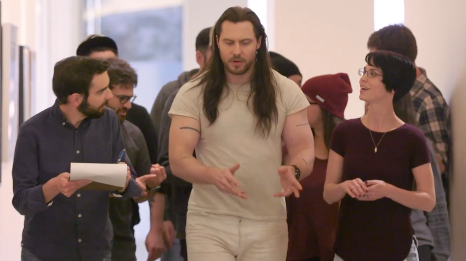 Andrew W.K. walks and talks with his team of supporters in a scene for a new video announcing the formation of the Party Party. (Courtesy the artist)