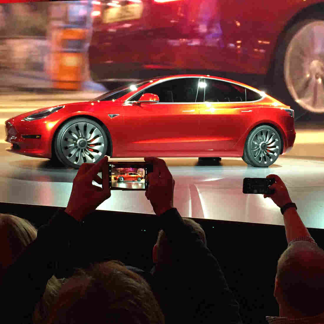 Tesla Motors unveils the new lower-priced Model 3 sedan in Hawthorne, Calif., on Thursday.