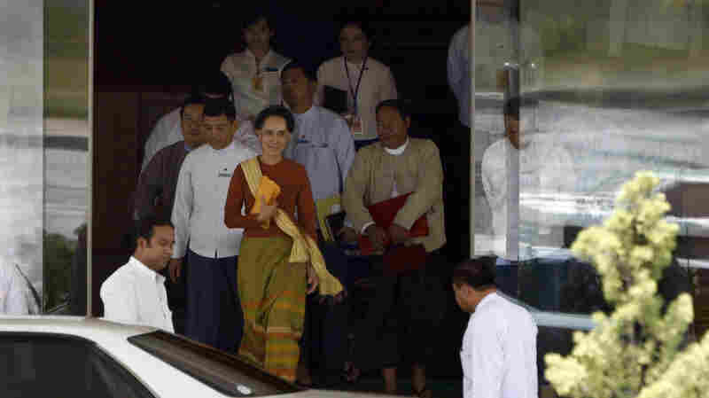 Myanmar Foreign Minister Aung San Suu Kyi (center) walks out of her ministry in Naypyitaw on Friday. Her ally U Htin Kyaw took over as Myanmar's president Wednesday.