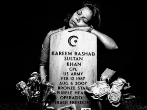Elsheba Khan at the grave of her son, Spc. Kareem Rashad Sultan Khan, in Section 60 of Arlington National Cemetery, 2008. Spurred by the Sept. 11 attacks on the World Trade Center, Khan, a Muslim, enlisted immediately after graduating from high school in 2005 and was sent to Iraq in July 2006. He was killed a year later.