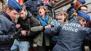 Belgian Authorities Arrest Protesters; Airport To Reopen
