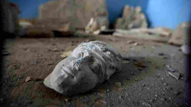 The face of a statue lies on the ground at the destroyed museum in the ancient Syrian city of Palmyra on March 31.