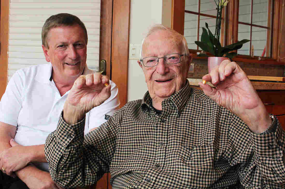Ed Robinson, who ran the J.C. Robinson Seed Co. for 58 years, with his son Rob Robinson (left).