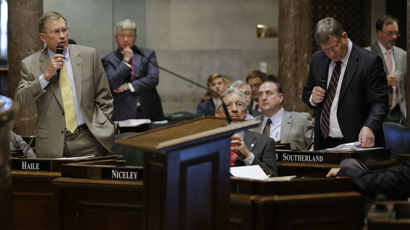 State Sen. Ferrell Haile, R-Gallatin (left), speaks during debate on a bill that would make the Bible the state book of Tennessee. At front right is Sen. Steve Southerland, R-Morristown, who sponsored the bill.