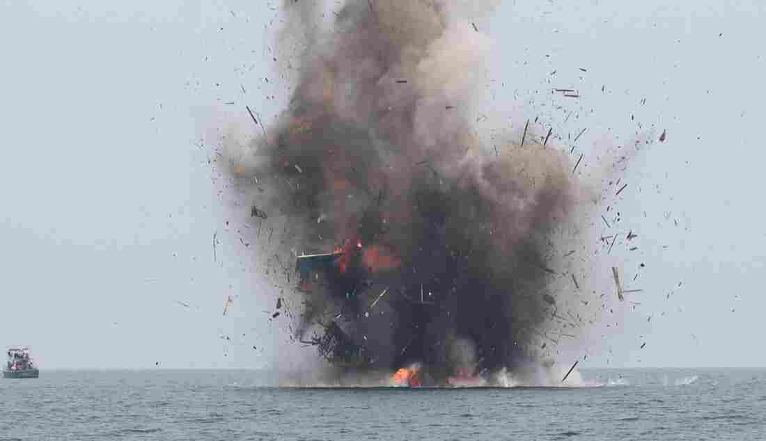 Smoke On The Water: Indonesia Blows Up Fishing Boats Of Poachers : Parallels : NPR