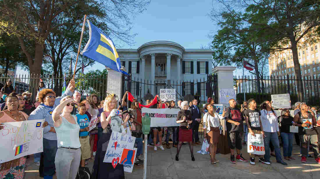A crowd of around 500 protest against House Bill 1523 outside the governor's office during a rally by the Human Rights Campaign on Monday in Jackson, Miss.