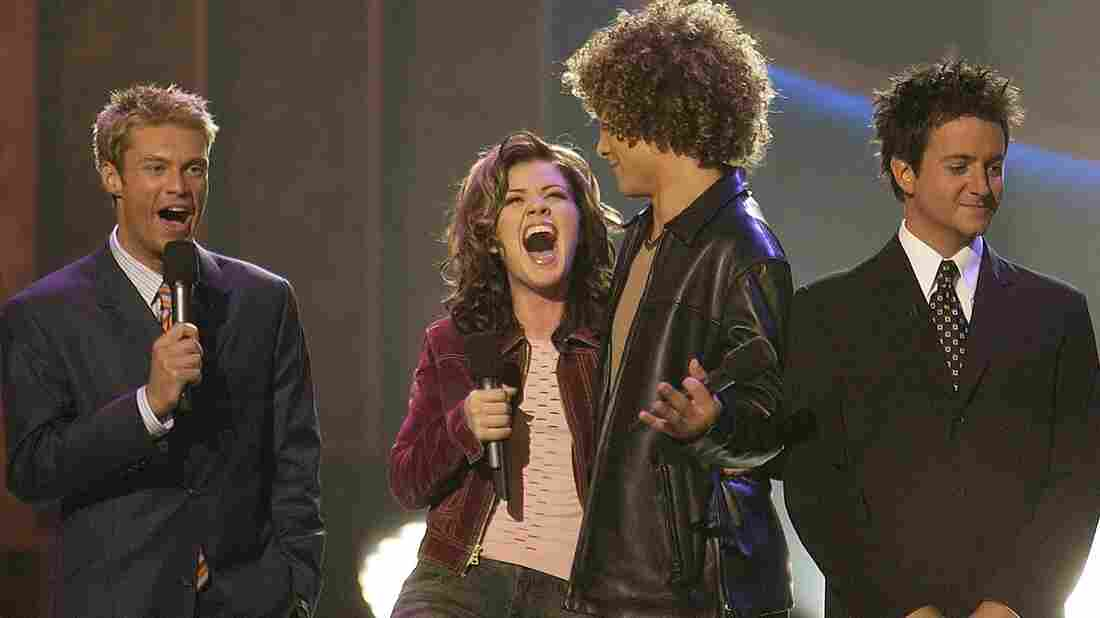 Kelly Clarkson won the first season of American Idol in September 2002 over Justin Guarini, in front of Ryan Seacrest and Brian Dunkleman, who almost looks aware that this would be his only season.