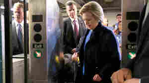 Democratic presidential candidate Hillary Clinton holds her MetroCard as she goes through the turnstile to enter the subway in the Bronx on Thursday.