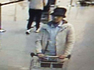 """The Belgian Federal Police released surveillance video of three men suspected of taking part in the attacks at Belgium's Zaventem Airport, including the """"man in the hat."""""""